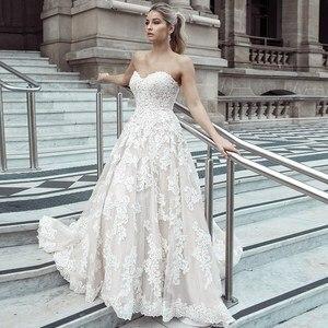 Image 1 - Lace Appliques Tulle A Line Wedding Dress Vestidos De Novia 2019 Elegant Strapless Robe De Mariée A Line Bridal Gown