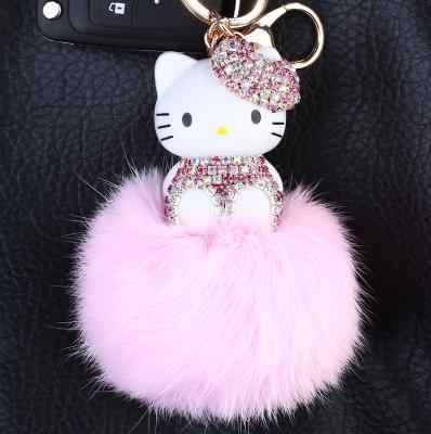 Olá kitty dos desenhos animados pérola coelho real pele pompom bola chaveiro titular do anel chave bolsa feminina charme pingente acessórios presente para a menina