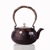 HOT SALE Chinese Style Cast Iron Plum Blossom Teapot Floral Half Handmade Coffee Pot Water Dispenser