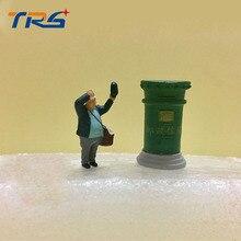 HO Scale model figures scene with Herpa models Preiser accessories 1:87 mailbox macroshot postman
