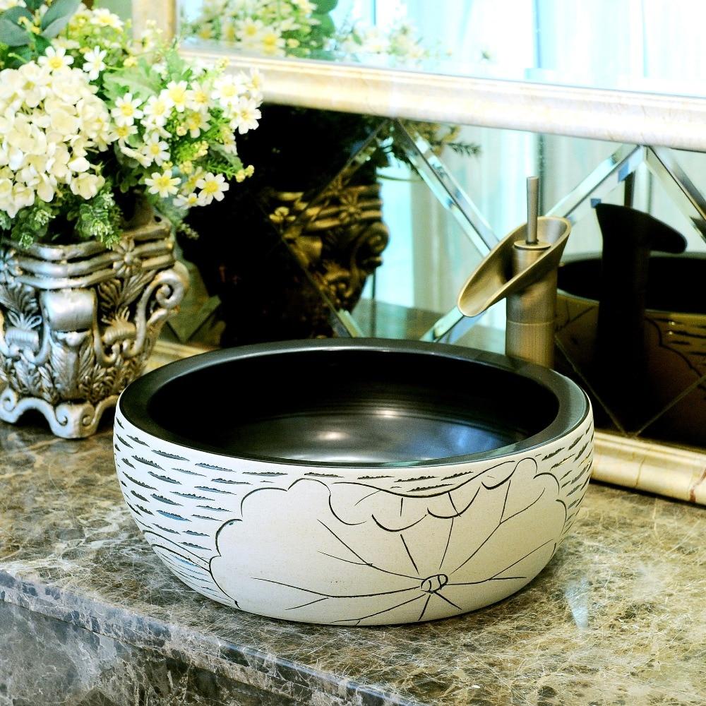 China Artistic Handmade Engraving Ceramic Lavobo Round Countertop round wash basin ceramic (3)