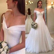 Vestido de novia de tul plisado con escote y hombros descubiertos, elegante