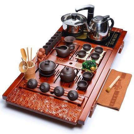 Zisha Kung Fu ensemble de thé en porcelaine plateau de thé paquet en bois massif tasse en céramique cuisinière à induction combinaison quatre en un
