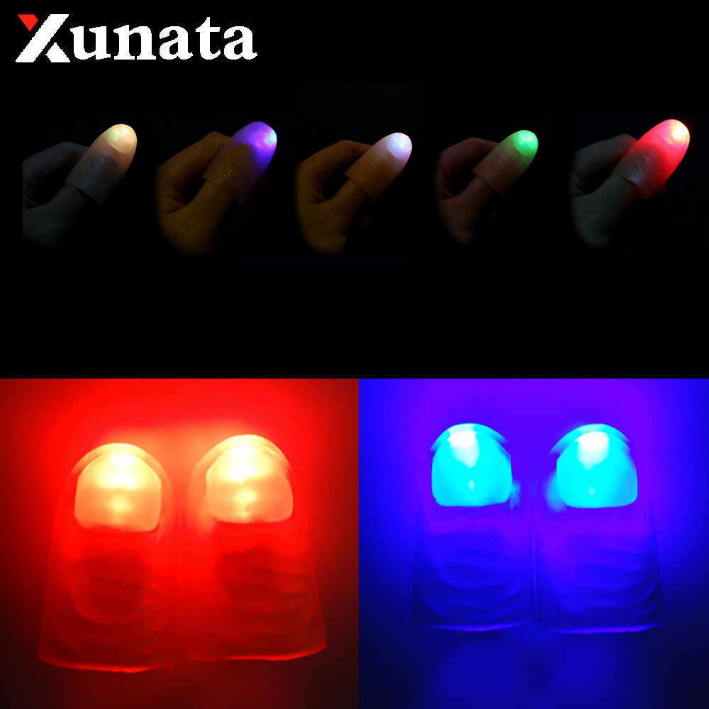 Luces de dedos mágicos LED parpadeante lámpara de dedo luz hacia arriba pulgar dedo cuna accesorios mágicos para truco mágico fiesta de Pascua Navidad prop
