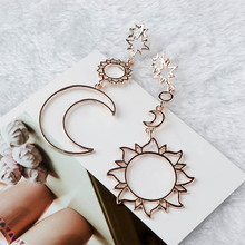 купить Women Fashion Dangle Long Earrings Hollow Out Star Moon Sun Asymmetry Geometric Drop Earrings Charm Jewelry по цене 69.04 рублей