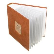 を保持している 200 写真スリップメモフォトアルバムの家族のメモリノートブック写真アルバム 200 写真写真アルバムブックフォトアルバム