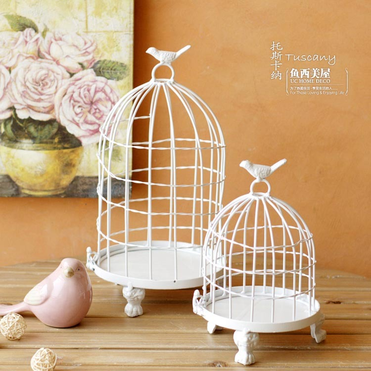 White birdcage candlestick wedding decoration