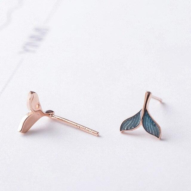 Фото женские серьги гвоздики flyleaf из розового золота и синей глазури цена