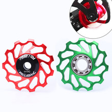 цена на RISK mtb bike rear derailleur pulley Al 7075 cnc 11t ceramic Bearing jockey wheel for shimano xt derailleur 4 color
