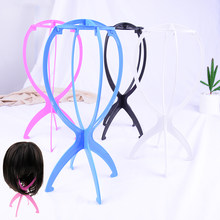 JETTING Hot Sale 1PC Wig Stand Plastic Wig Holders Display Portable Folding Stable Wig Stand Tool Black/Blue/White/Pink(China)