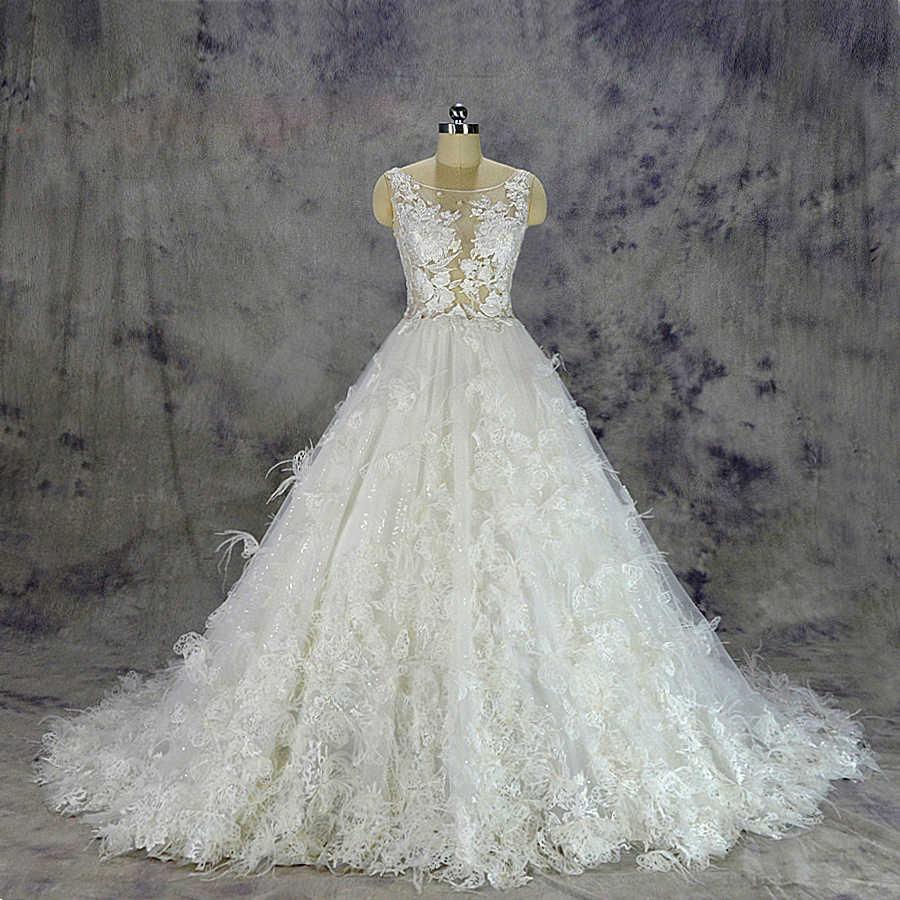 2019 Luxurious Feather Wedding Dress Sexy Transparent Top Bridal