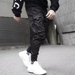 Image 2 - Men Ribbons Color Block Black Pocket Cargo Pants 2019 Casual Fashion Harem Joggers Harajuku Sweatpant Hip Hop Trousers LA8P36