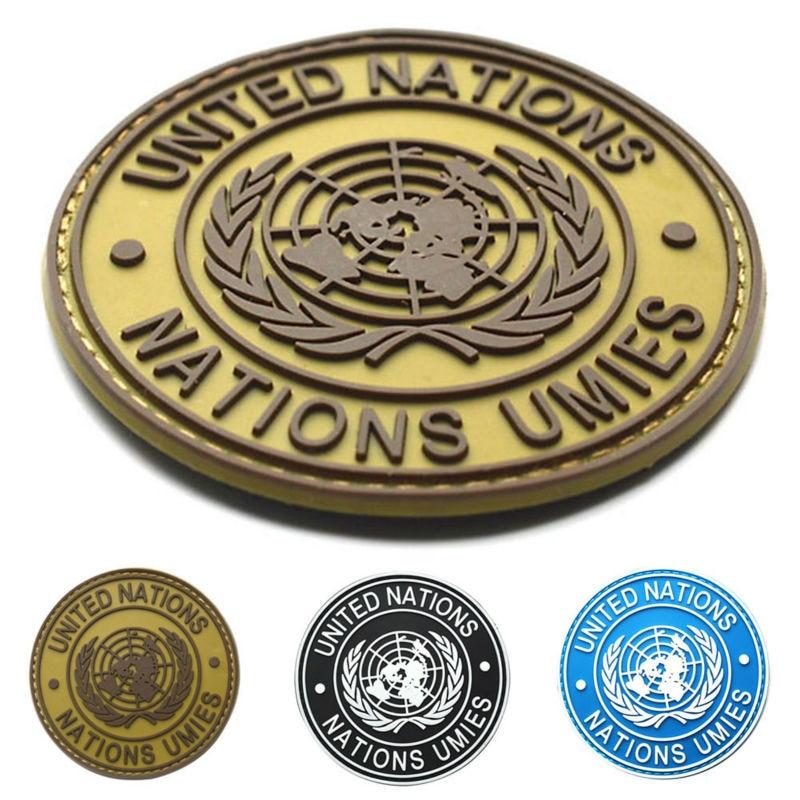 International U.N UN United Nations Genuine Shoulder Badge Mud Color E5M1