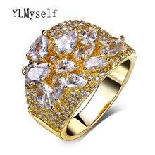 Женское кольцо с каплевидными камнями золотистое фианитами Прямая
