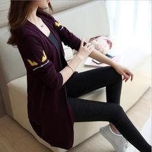 autumn womens clothing Korean fashion long-sleeved small monster eyes sweater cartoon jacquard loose sweater cardigan