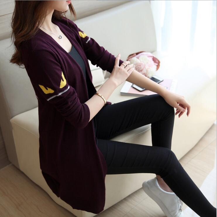 autumn womens clothing Korean fashion long sleeved small monster eyes sweater cartoon jacquard loose sweater cardigan