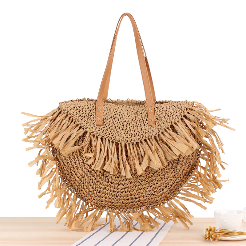 New semi-circular tassel shoulder straw bag spike paper woven bag beach fashion handbagNew semi-circular tassel shoulder straw bag spike paper woven bag beach fashion handbag