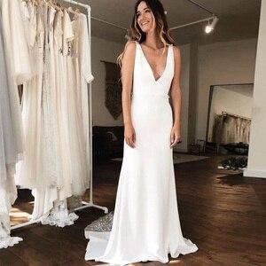 Image 2 - Sexy głębokie dekolt w serek suknie ślubne syrenka biała kość słoniowa 3D koronkowa szata De Maria Backless kaplica pociąg Vestido De Noiva Custom Made