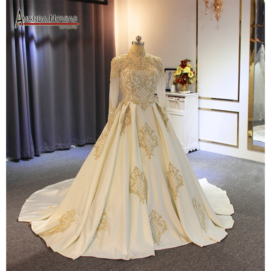 2019 Muslim satin wedding dress with high neckline with golden lace