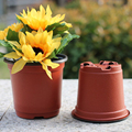 100pcs Rodada Potes Berçário Plástico Pequeno Vaso de Flores Projeto Oco Para Berçário Plantador Plantador de Terracota Jardim Home Decor Diy Suprimentos