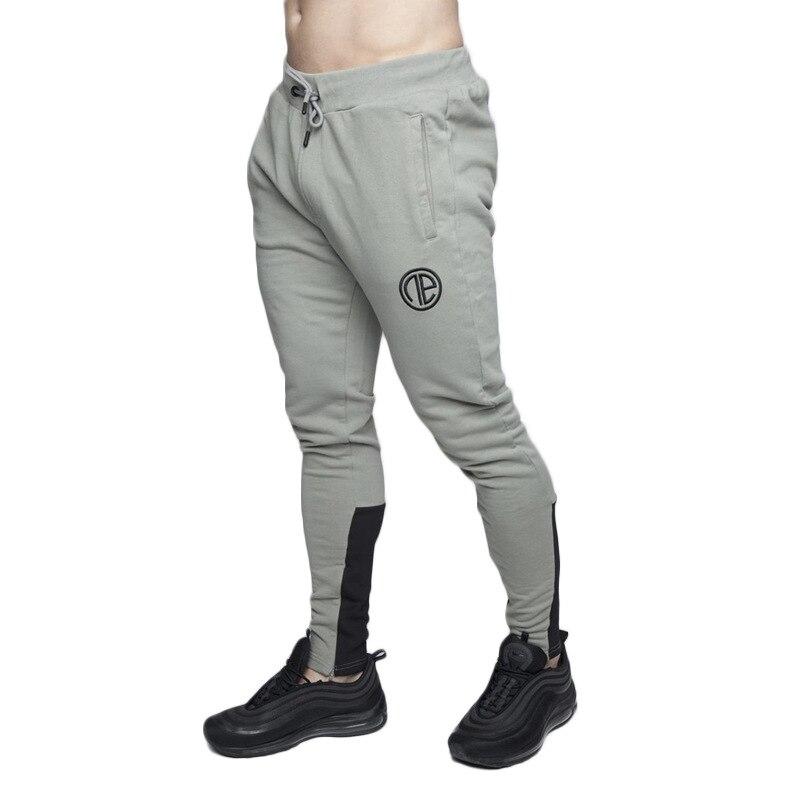 Flambant neuf GYMNASES Hommes Joggers Pantalon Fitness décontracté Marque De Mode pantalons de survêtement jogging Fond Snapback Pantalon pantalon décontracté homme