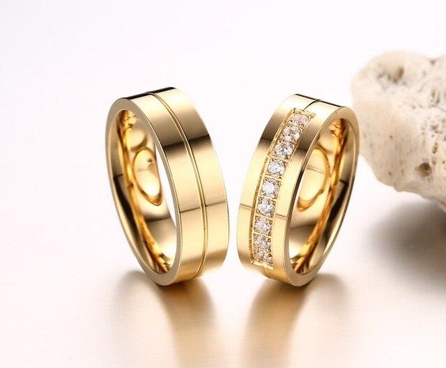 Фото женские и мужские кольца из нержавеющей стали с фианитом