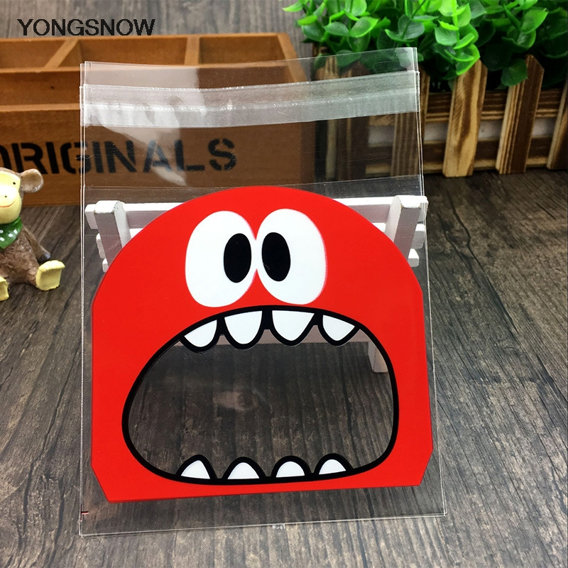 50pcs Christmas Decoration Cute Monster Sharp Teeth Plastic Bags Xmas Gift Packaging Bags Wedding New Year Candy Bag OPP Pouches