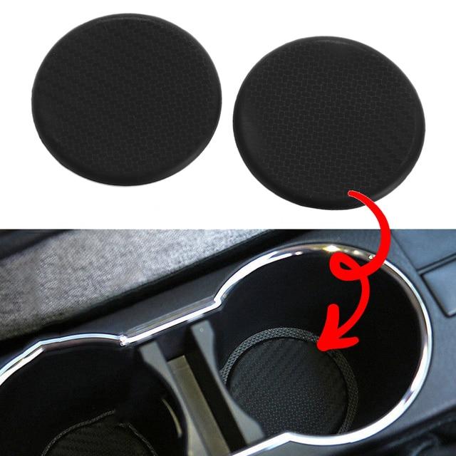 2 pc silicone preto carro auto copo de água slot antiderrapante acessórios da esteira de fibra de carbono almofada protetora do carro acessórios interiores do carro