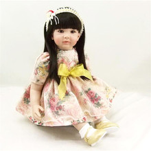 22 inch 55 cm baby reborn  Silicone dolls, lifelike doll reborn babies toys Fashion flower yarn skirt girl