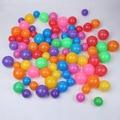 100 unids/lote juguetes para niños Grandes 5.5 cm gruesa bola elástica de plástico de colores Juego de regalos para niños de Colores Bola Marina Bolas del océano