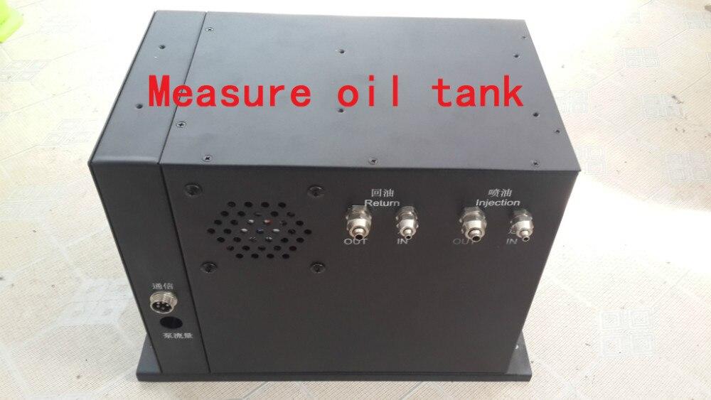 Réservoir d'huile de mesure de pesage, besoin de coopérer avec le système de contrôle de rail commun