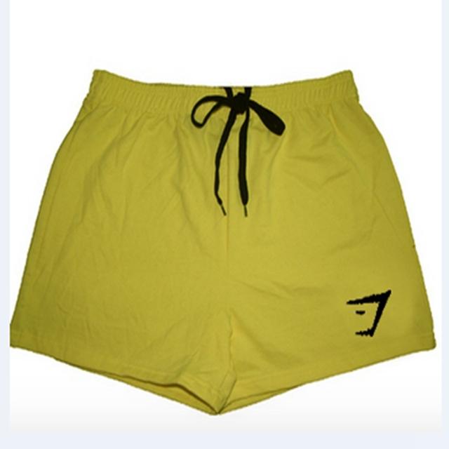 Pantalones cortos ajustados de los hombres de secado rápido tight gimnasio chándal pantalones de compresión pantalones tres puntos