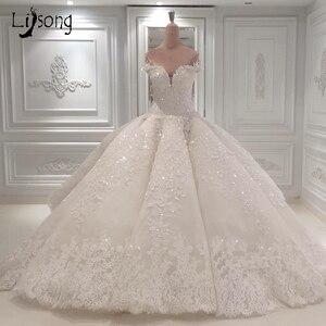 Image 1 - Luxo dubai rendas vestidos de casamento brilho frisado cristal rendas vestidos de noiva ilusão árabe voltar vestido de noiva 2018