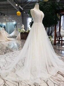 Image 3 - LSS508 ボヘミアンウェディングドレス v ネックノースリーブ a ライン格安ウェディングドレスシンプルなビーチブライダルドレス vestidos デ noiva 2020