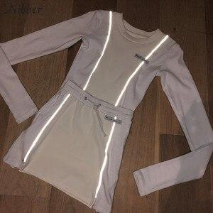 Image 2 - Nibber moda reflexivo retalhos roupas esportivas 2 peças define femme 2019new branco tricô topos feminino t mini camisas saias ternos