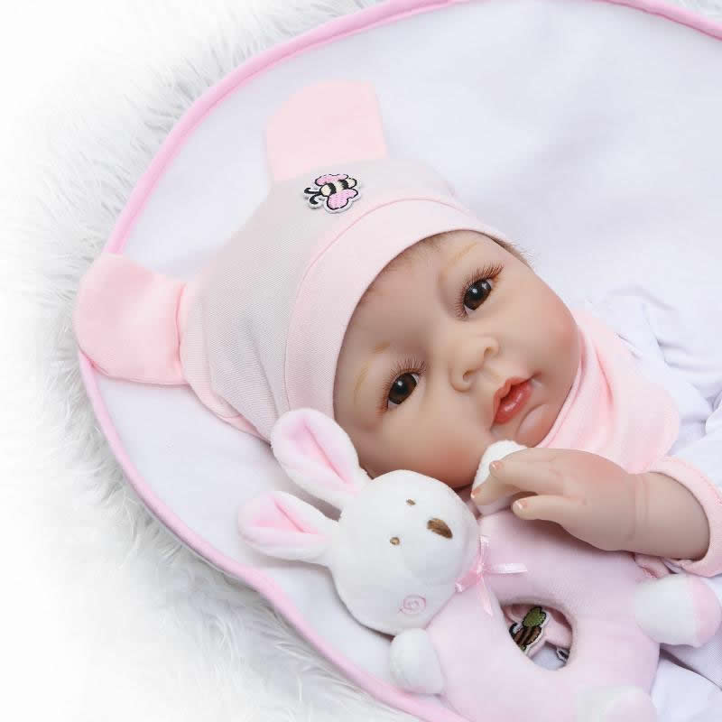 NPKCOLLECTION 22'' Dolls with Pink Hat Lifelike Silicone Reborn Baby Doll Touch Soft Real Girl Infant Kids Toy Playmates Gifts smile reborn girl with blue dress 22 lifelike baby dolls soft silicone fashion kids toy xmas gifts reborn baby doll for sale