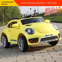 The new Volkswagen Beetle children electric car double drive wheel swing four luminous baby stroller ca
