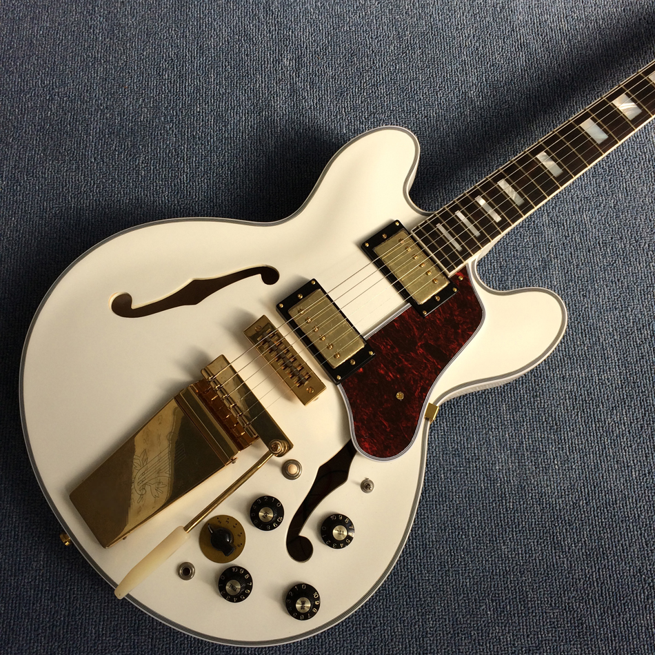 New style high-quality hollow body jazz electric guitar, Double F holes,Ebony Fingerboard,Tremolo system,white guitar