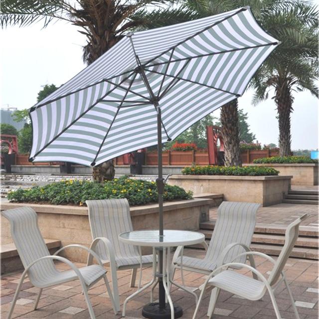Exterior patio umbrella océano del sol terraza jardín mesas de café ...
