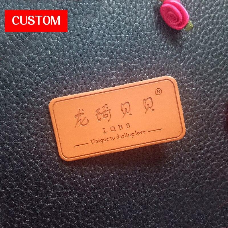Logo en relief en cuir PU en métal personnalisé usine couture sur vêtements marque privée marque principaux signes pour vêtements