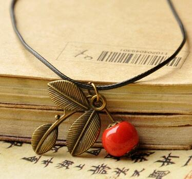 Classic style hand woven leather ceramic pendant necklace with apple classic style hand woven leather ceramic pendant necklace with apple and leaves neck chain jewelry for female in pendant necklaces from jewelry mozeypictures Gallery