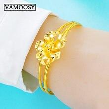 Женский браслет из 24 каратного золота с вырезанными золотыми
