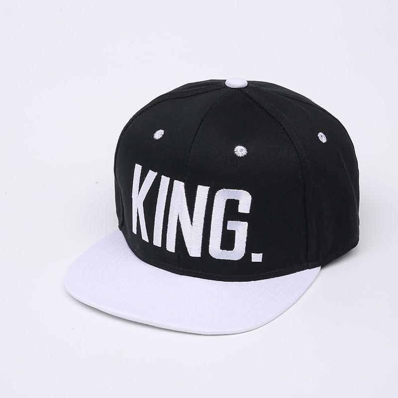 "Embroidered ""King and Queen"" Snapback Cap Set - Black King Cap with White Embroidery, White Brim, White Eyelets and White Button Top"
