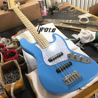 The new Jazz 5 string bass guitar, blue body, maple fingerboard, pearl shell inlaid with chrome hardware can be customized