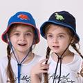 Bebés y niños niñas niños nuevo 2016 verano algodón dinosaurio cubo sombreros de sol niños de dibujos animados ocasional azul gorras de moda jugar sombrero