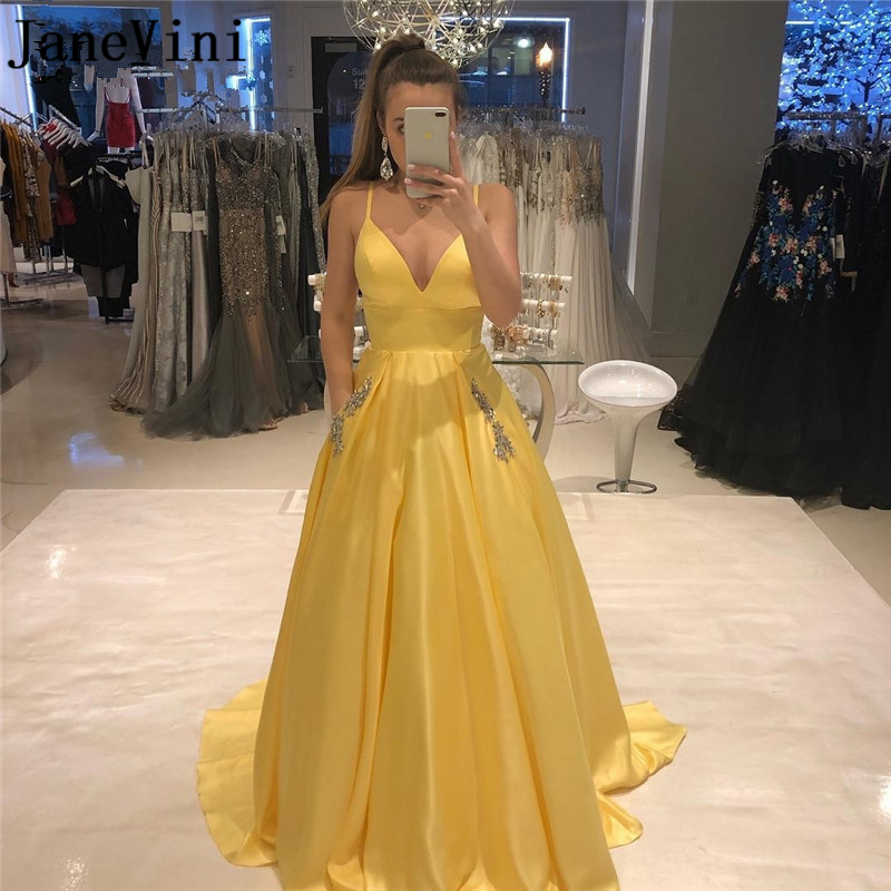 JaneVini 2019 Elegant Yellow Satin Long   Prom     Dresses   with Pockets Beaded Spaghetti Straps Open Back A Line Formal Party Gowns