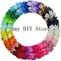 Envío Gratis 40 unids 40 Colores Baby Girl Hair Boutique arco de La Cinta Molinete Arquea CON Pinzas de Cocodrilo Para Niños de Los niños bebés Adolescente