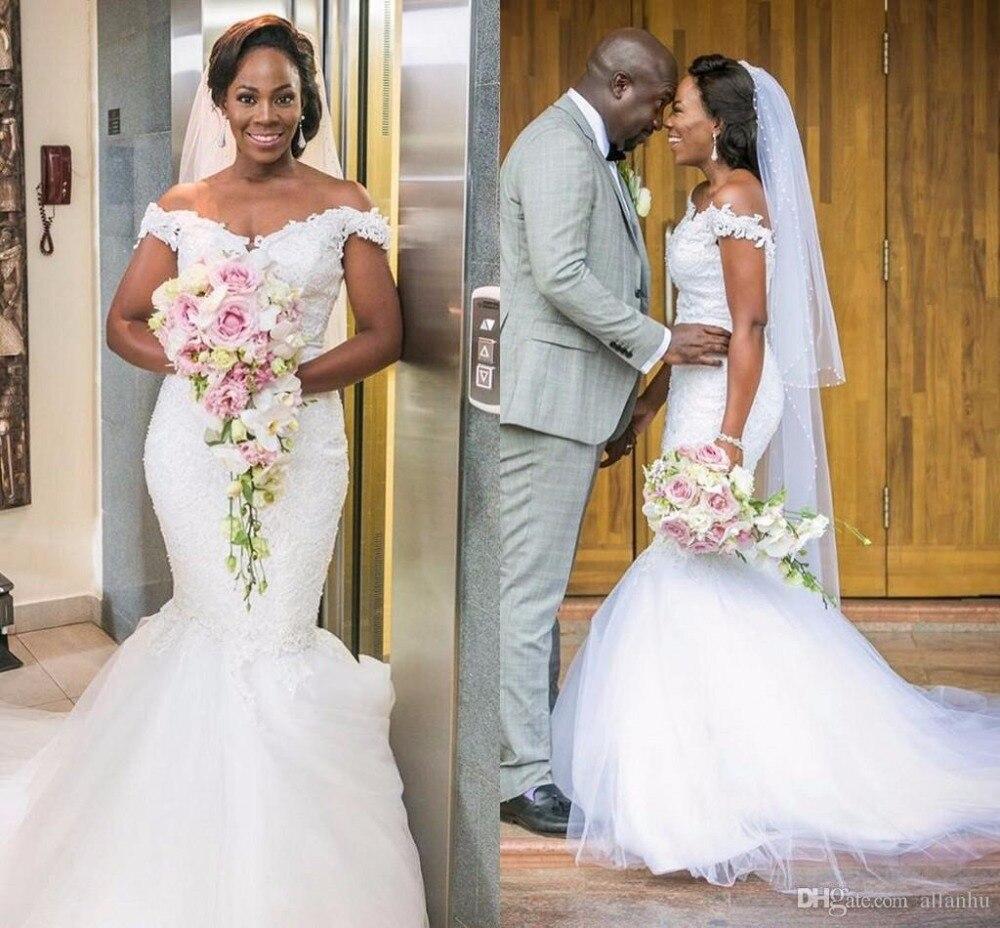 ee34b05722d 2018 Nigerian African New Mermaid Wedding Dresses Off Shoulder Lace  Applique Backless Chapel Train Wedding Bridal Gowns