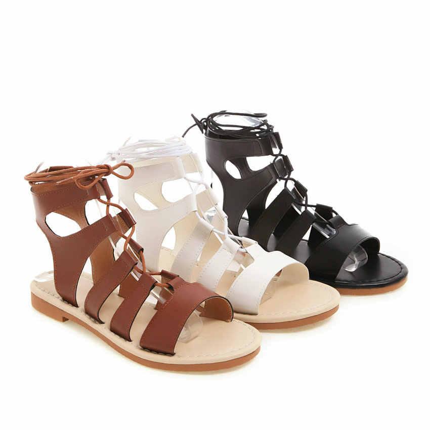 QUTAA 2020 kadın sandalet yeni yaz dantel Up seksi Cut çıkışları yuvarlak açık parmaklı PU deri roma serin botlar bayan ayakkabı boyutu 34-43