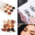 9 colores cálidos mujeres profesionales de la moda señoras kyli de sombra de ojos maquillaje cosmético shimmer mate sombra de ojos naked palette